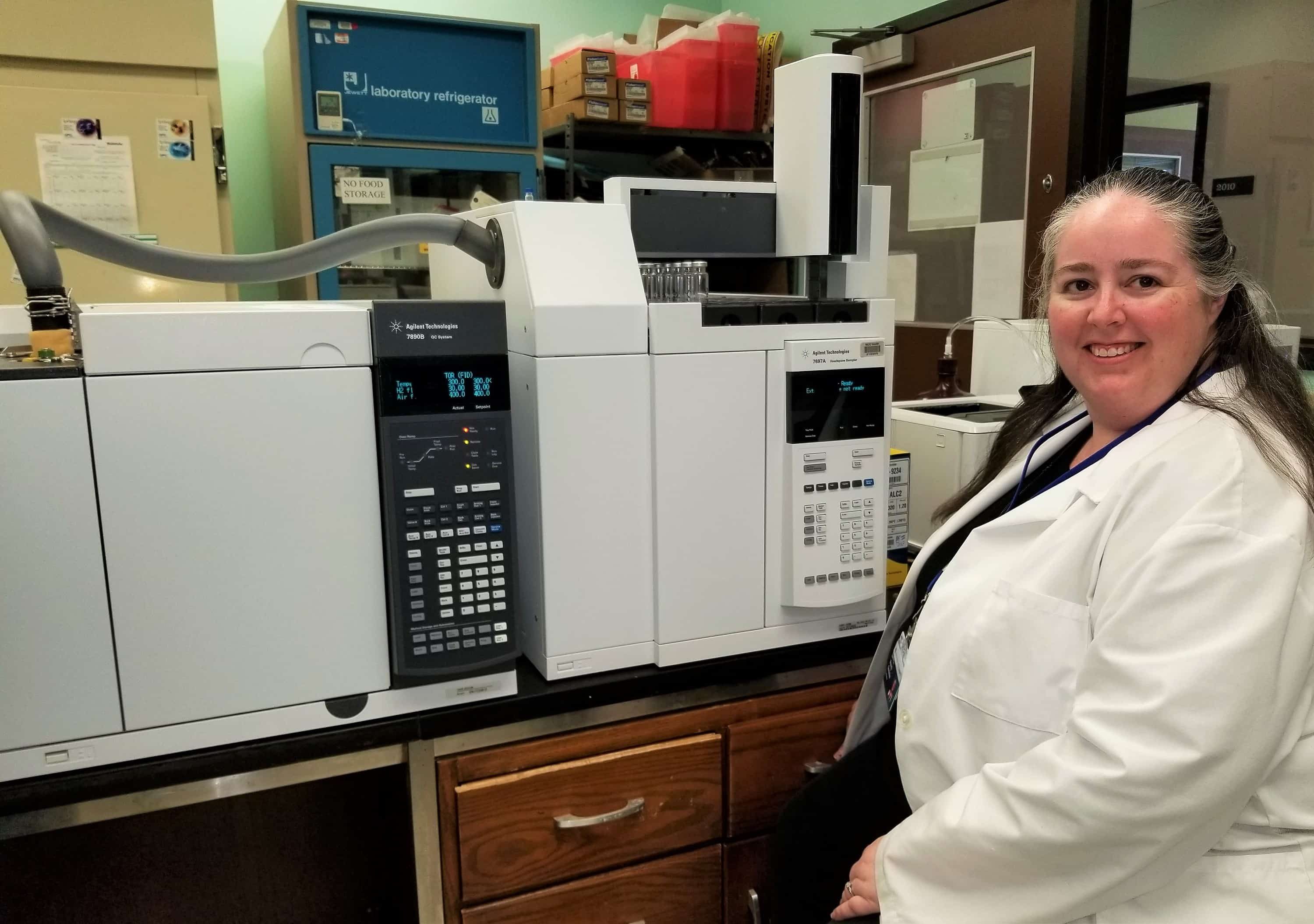 First DCLS graduate, Brandy Gunsolus in lab with equiptment