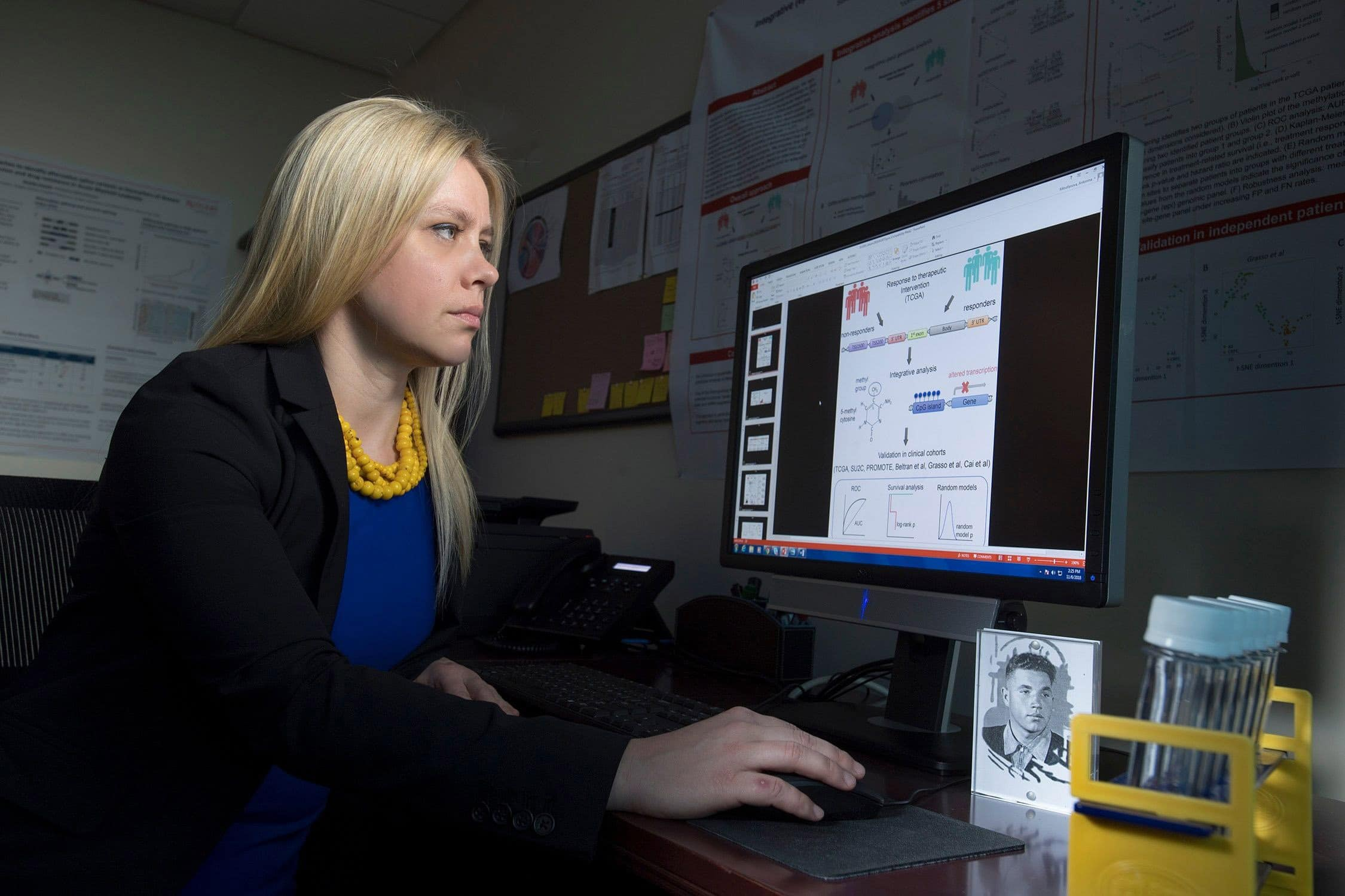 Assistant Professor Antonina Mitrovanova conducts health informatics research working with data in her computer lab.