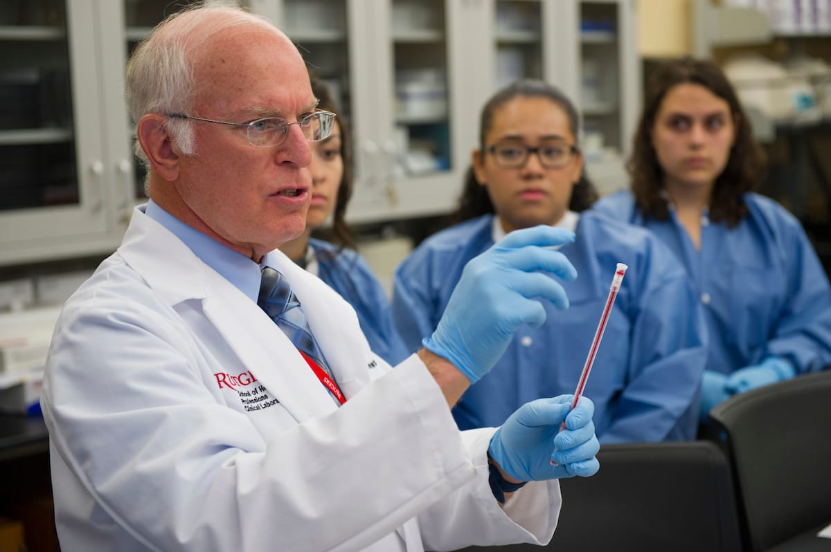 Health Professions professor instructing students in lab