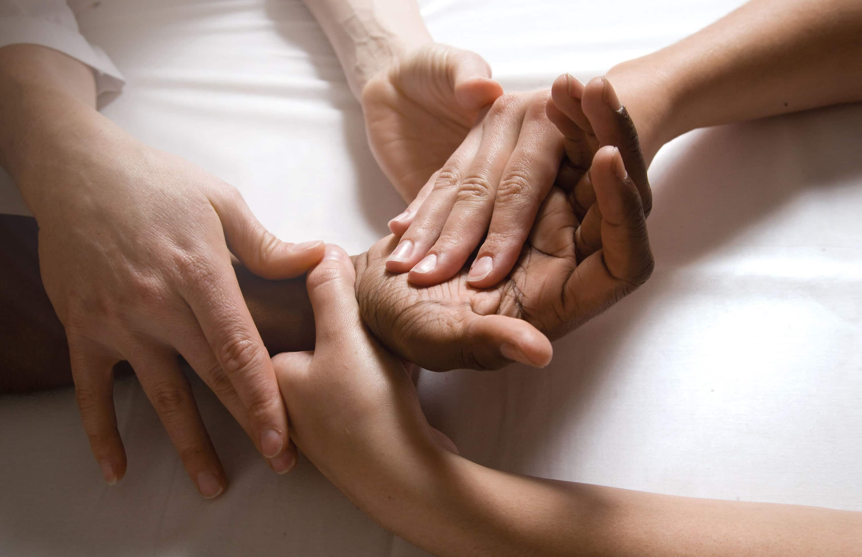 hands massaging hands