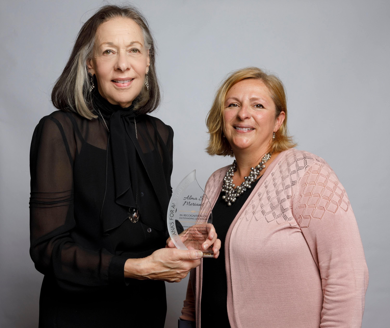 Prof. Alma Merians and Dean Gwen Mahan pose with an award