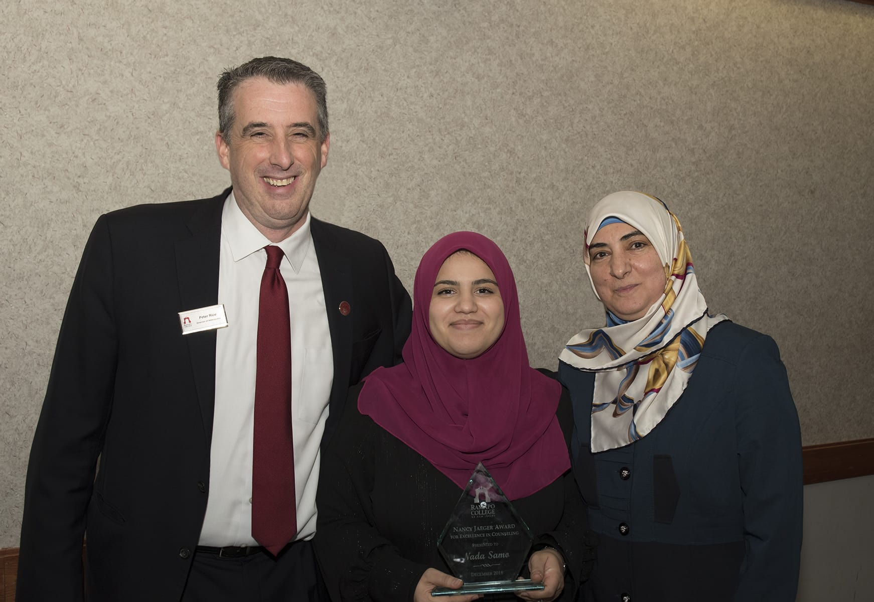 Rehab Counseling student Nada Samo holds award she received for Excellence in Counseling