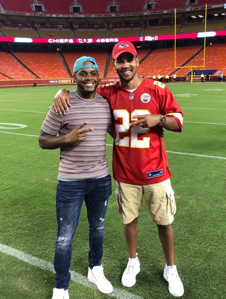 Juan Thornhill and Donnie Montague on the Kansas City Chiefs field