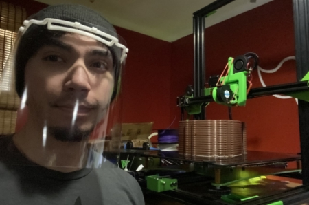 Joseph Rodriguez wearing a clear plastic 3D mask